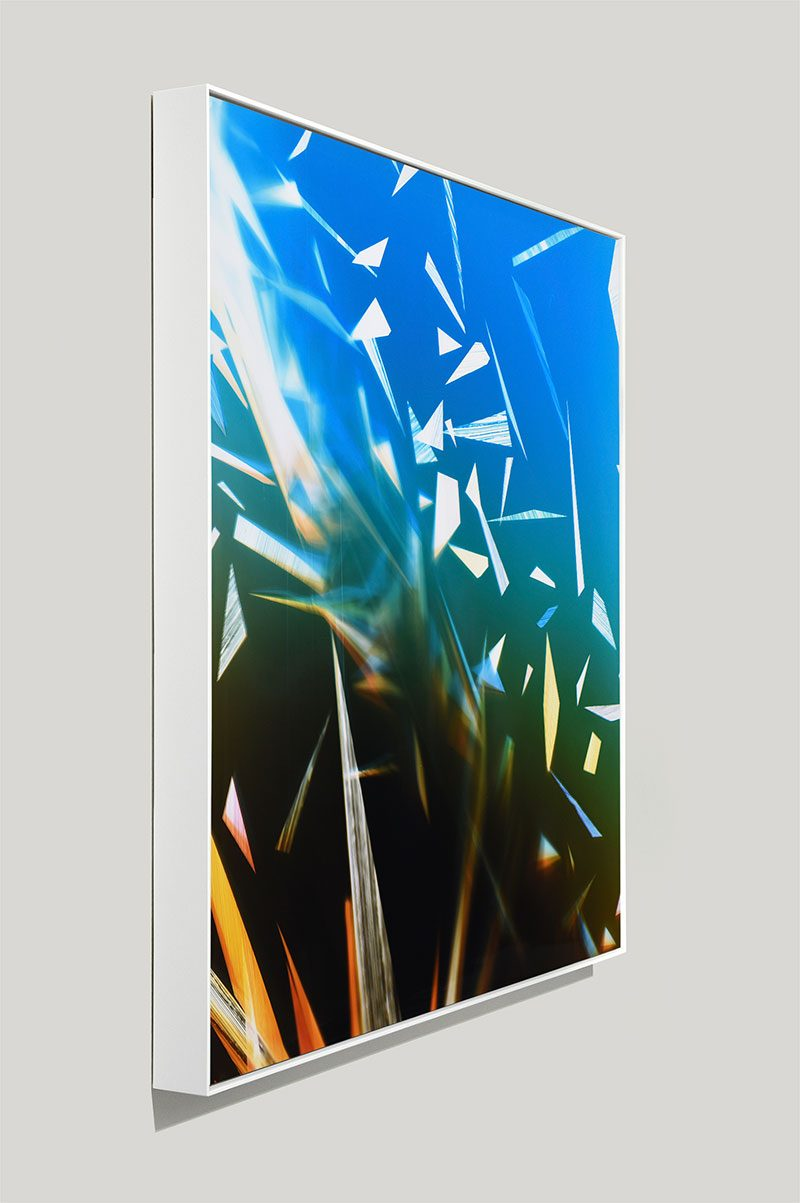 side view of color photogram titled: Airless-Weight from the series Precariously Bright
