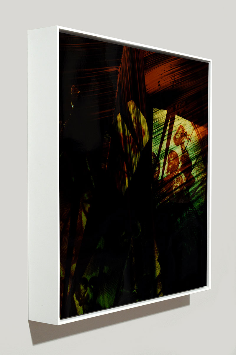 side view of framed color photogram titled: Fond of Stories