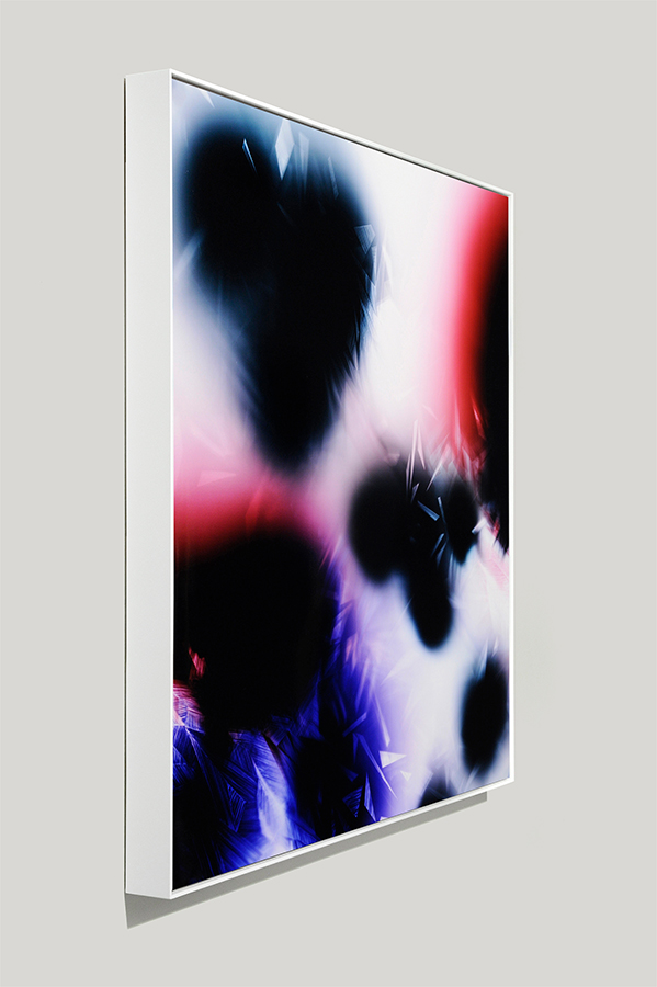 Framed art side view of abstract color photogram titled: In Formation from the Cascades Series