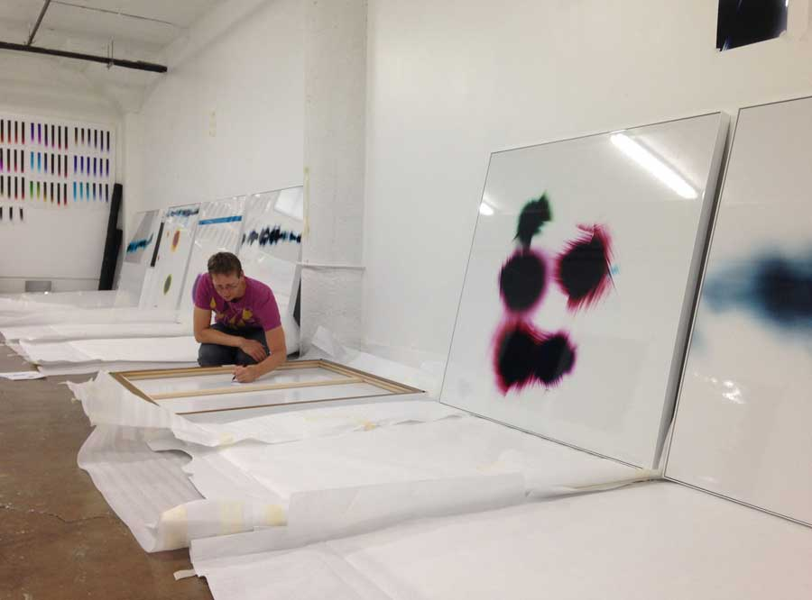 Signing the artworks to prepare for first Museum Exhibition
