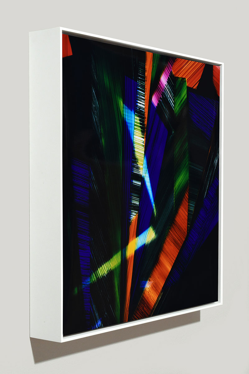 side view of framed color photogram titled: Labyrinth of Memories