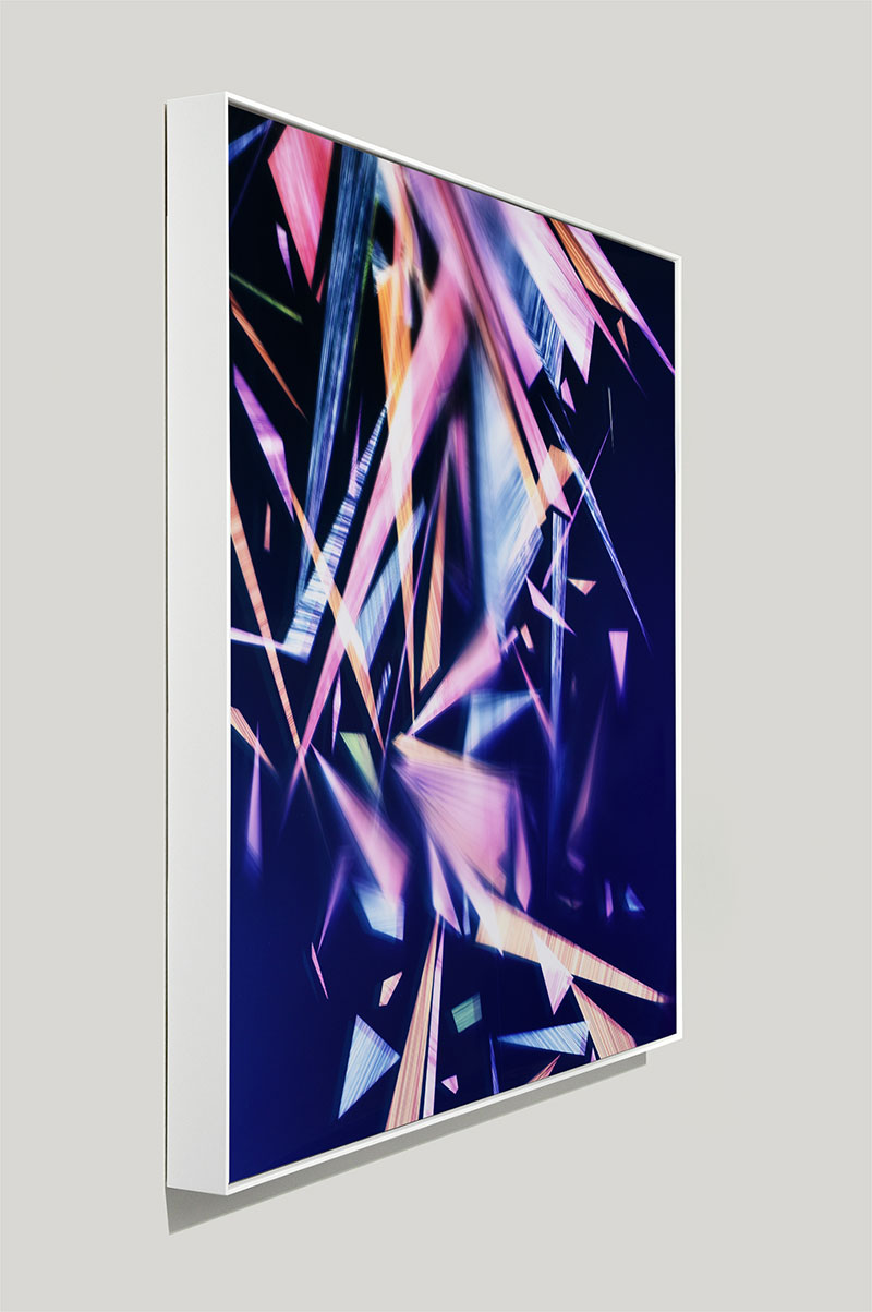 side view of Framed color photogram titled: Paragon En Masse