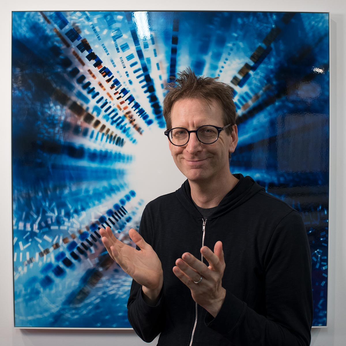 Portrait of Artist Richard Slechta with color Photogram, titled Pressure Discontinuity