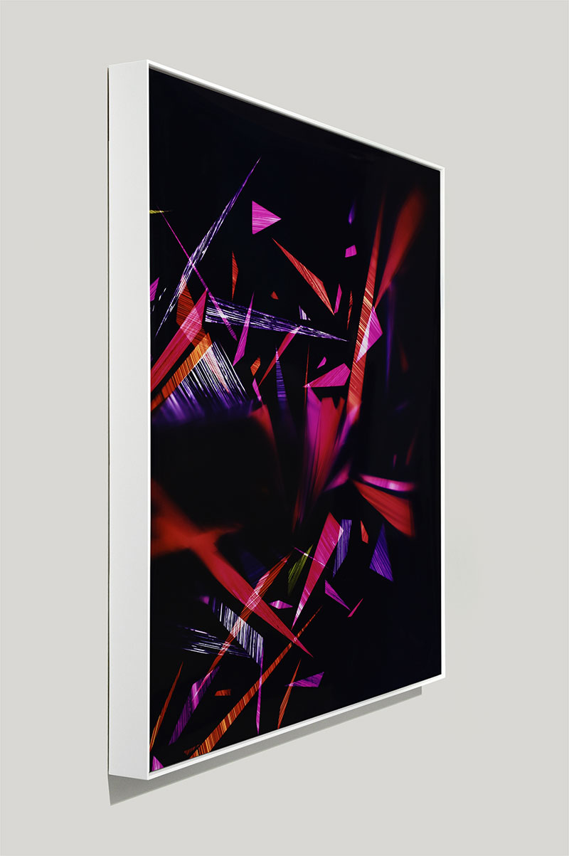 side view of framed color photogram titled: Sticky Trigger Reflex from the series Precariously Bright